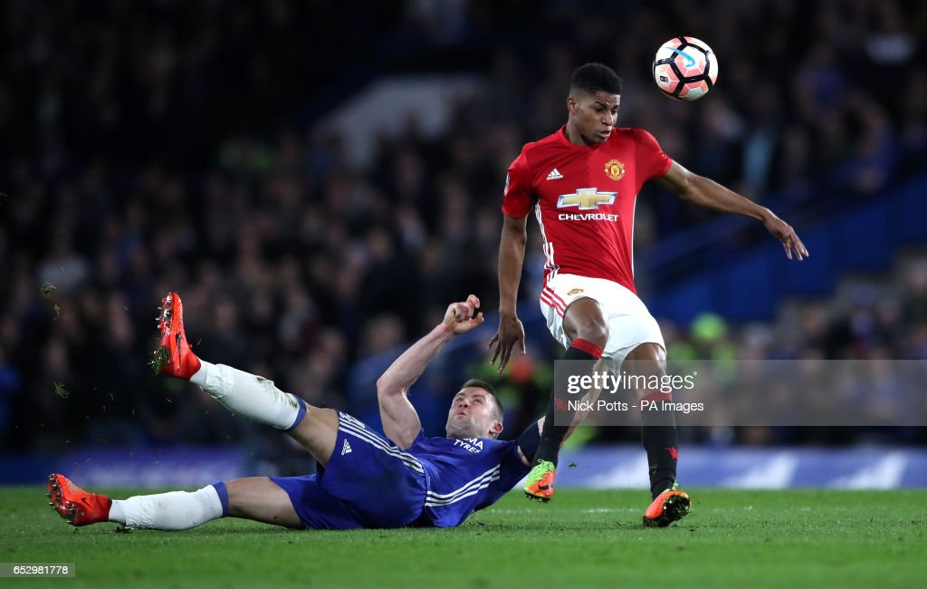 Chelsea's Gary Cahill challenges Manchester United's Marcus Rashford (right) during the Emirates FA Cup, Quarter Final match at Stamford Bridge, London.