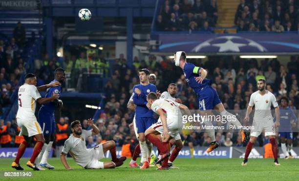 Chelsea's Gary Cahill heads the ball during the UEFA Champions League Group C match at Stamford Bridge London