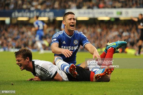 Chelsea's Gary Cahill sits on Fulham's Scott Parker after a challenge