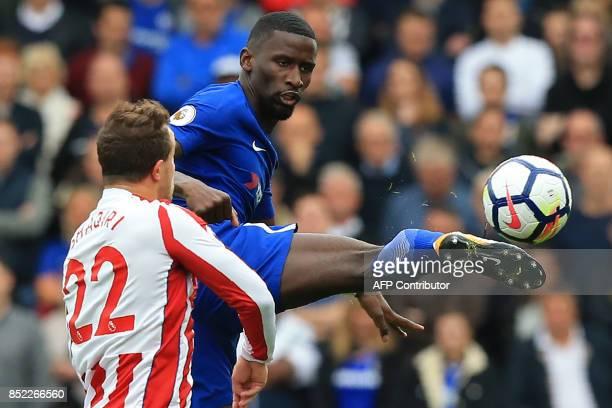 Chelsea's German defender Antonio Rudiger vies with Stoke City's Swiss forward Xherdan Shaqiri during the English Premier League football match...