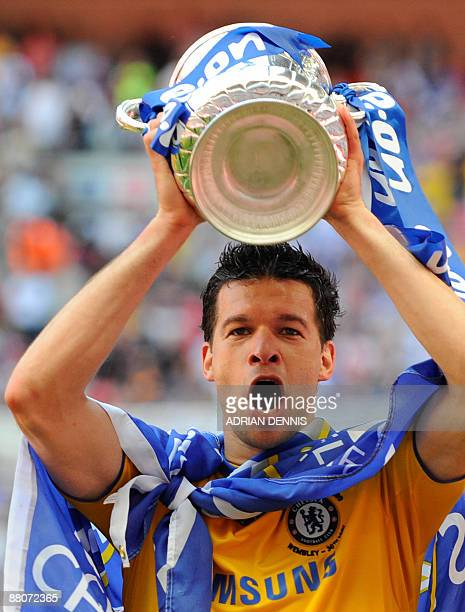 Chelsea's German footballer Michael Ballack celebrates with the FA Cup after his team beat Everton 21 in the final at Wembley in north Londonon May...