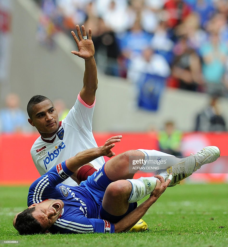 Chelsea's German midfielder Michael Ballack (Foreground) cries out in pain as he is tackled by Portsmouth's Kevin-Prince Boateng during the FA Cup Final football match at Wembley, in north London, on May 15, 2010. AFP PHOTO/ADRIAN DENNIS FOR EDITORIAL USE Additional licence required for any commercial/promotional use or use on TV or internet (except identical online version of newspaper) of Premier League/Football League photos. Tel DataCo +44 207 2981656. Do not alter/modify photo
