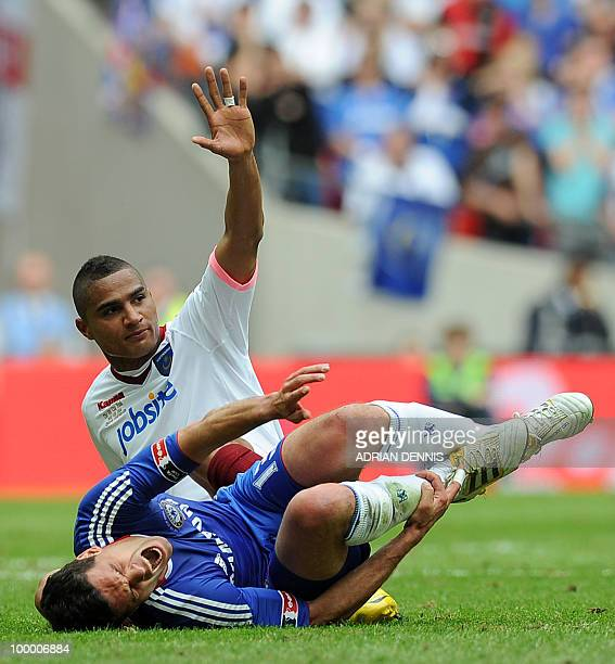 Chelsea's German midfielder Michael Ballack cries out in pain as he is tackled by Portsmouth's KevinPrince Boateng during the FA Cup Final football...