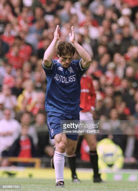 Chelsea's Gianfranco Zola celebrates by clapping his hands above his head after scoring a goal