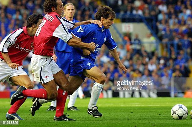 Chelsea's Gianfranco Zola holds off Arsenal's Gilles Grimandi during the premiership match at Stamford Bridge in London 08 September 2001 The game...