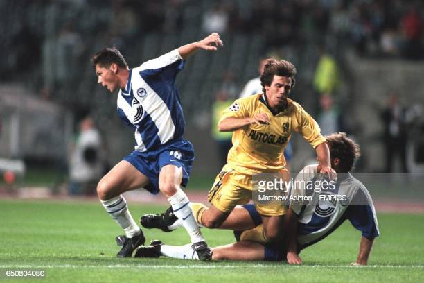 Chelsea's Gianfranco Zola is tackled by a combination of Hertha Berlin's Pal Dardai Dick Van Durik