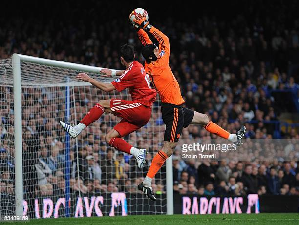 Chelseas goalkeeper Petr Cech makes a save next to Albert Riera of Liverpool during the Barclays Premier League match between Chelsea and Liverpool...