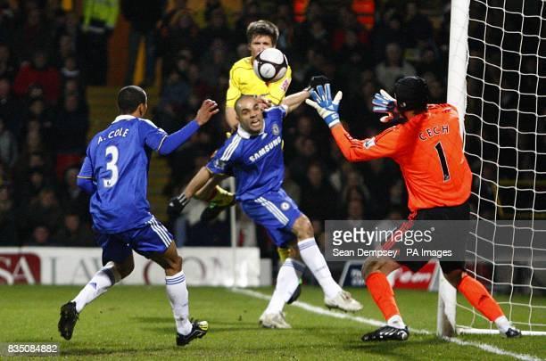 Chelsea's goalkeeper Petr Cech makes a save to deny Watford's Grzegorz Rasiak
