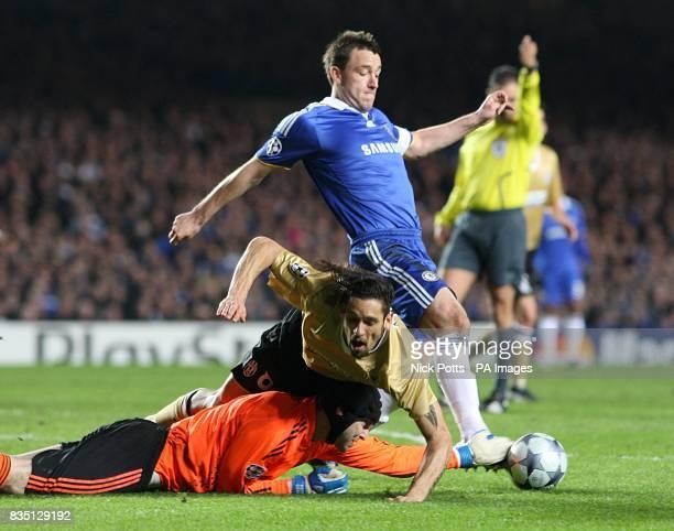 Chelsea's goalkeeper Petr Cech saves ahead of Juventus' Carvalho de Oliveira Amauri and teammate John Terry