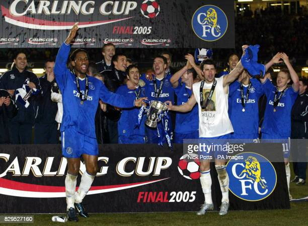 Chelsea's goalscorers Didier Drogba and Mateja Kezman with the Carling Cup trophy in front of teammates after defeating Liverpool