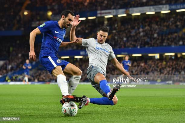 Chelsea's Italian defender Davide Zappacosta vies with Everton's English defender Leighton Baines during the English League Cup fourth round football...