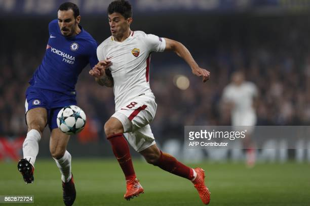 Chelsea's Italian defender Davide Zappacosta vies with Roma's Argentinian midfielder Diego Perotti during a UEFA Champions league group stage...