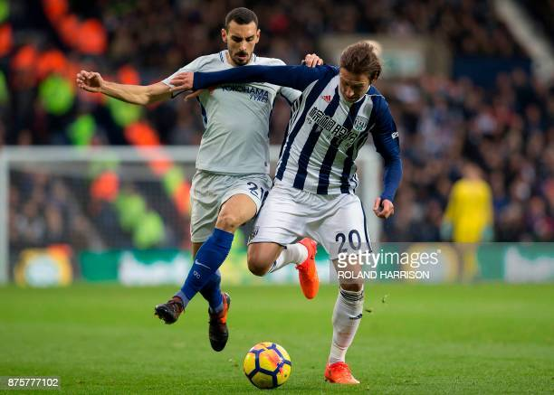Chelsea's Italian defender Davide Zappacosta vies with West Bromwich Albion's Polish midfielder Grzegorz Krychowiak during the English Premier League...
