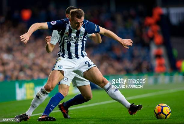 Chelsea's Italian defender Davide Zappacosta vies with West Bromwich Albion's Northern Irish defender Gareth McAuley during the English Premier...