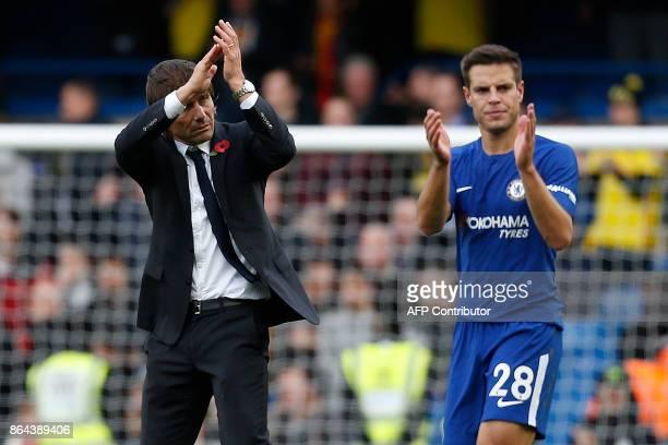 Chelsea's Italian head coach Antonio Conte and Chelsea's Spanish defender Cesar Azpilicueta applauds the fans following the English Premier League...
