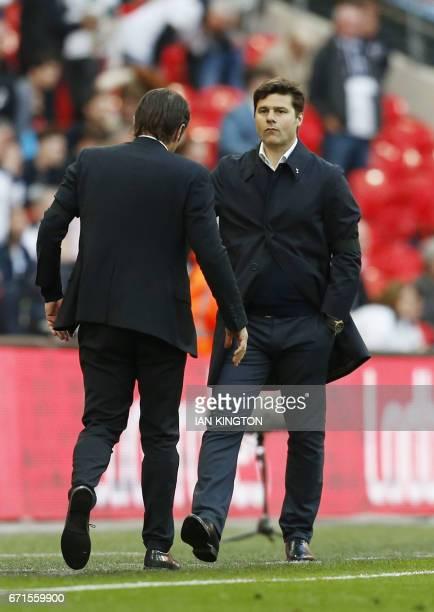 Chelsea's Italian head coach Antonio Conte and Tottenham Hotspur's Argentinian head coach Mauricio Pochettino gesture on the touchline during the FA...