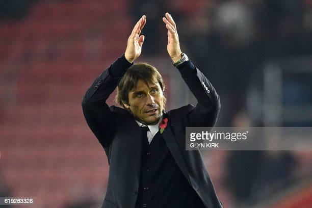 Chelsea's Italian head coach Antonio Conte applauds supporters after the English Premier League football match between Southampton and Chelsea at St...