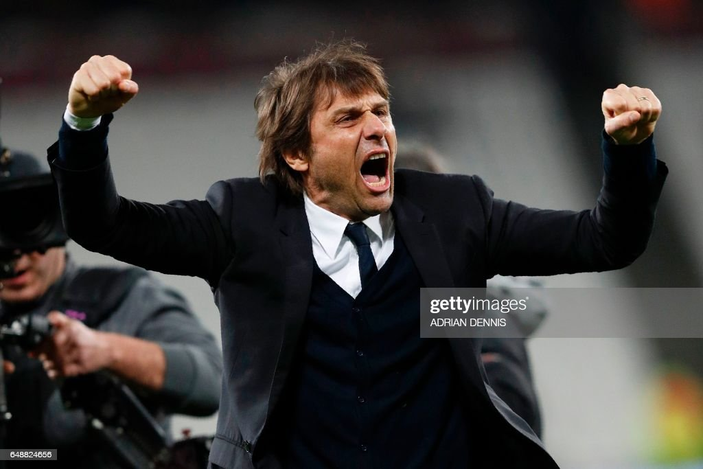 TOPSHOT - Chelsea's Italian head coach Antonio Conte applauds the fans following the English Premier League football match between West Ham United and Cheslsea at The London Stadium in east London on March 6, 2017. Chelsea won the match 2-1. / AFP PHOTO / Adrian DENNIS / RESTRICTED TO EDITORIAL USE. No use with unauthorized audio, video, data, fixture lists, club/league logos or 'live' services. Online in-match use limited to 75 images, no video emulation. No use in betting, games or single club/league/player publications. /