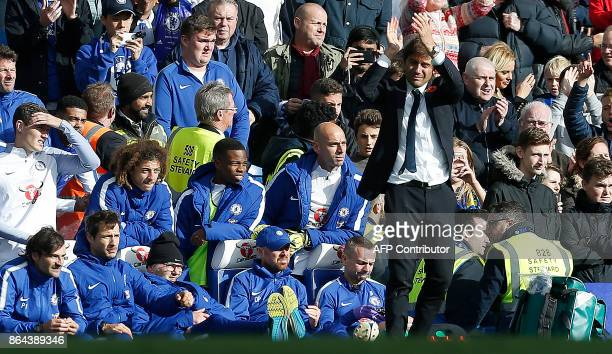 Chelsea's Italian head coach Antonio Conte applauds the fans following the English Premier League football match between Chelsea and Watford at...