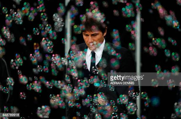 TOPSHOT Chelsea's Italian head coach Antonio Conte arrives ahead of the English Premier League football match between West Ham United and Cheslsea at...