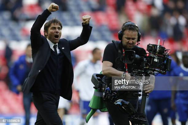 Chelsea's Italian head coach Antonio Conte celebrates after winning the FA Cup semifinal football match between Tottenham Hotspur and Chelsea at...