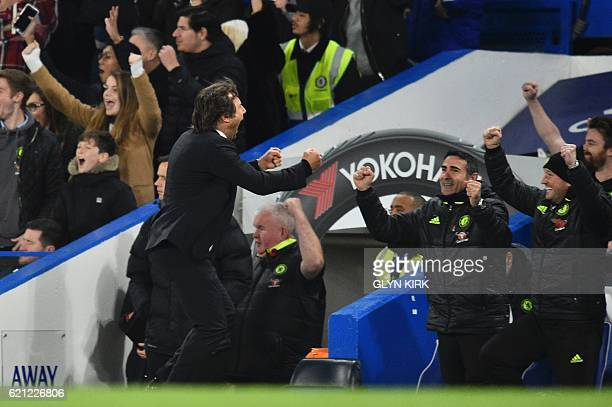 Chelsea's Italian head coach Antonio Conte celebrates as Hazard scores Chelsea's fourth goal during the English Premier League football match between...
