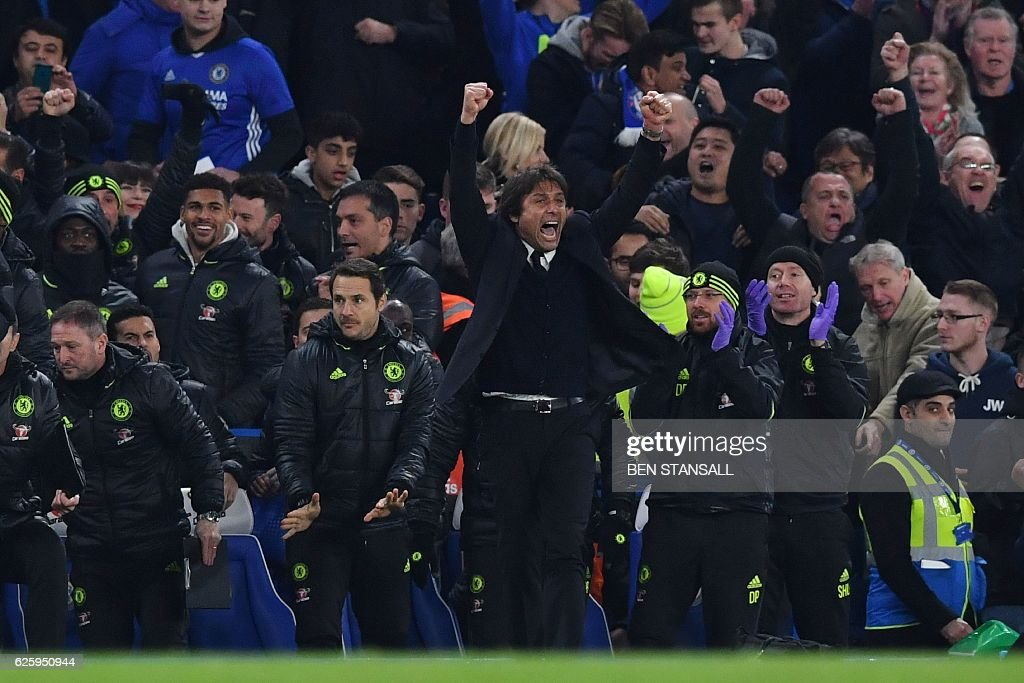 Chelsea's Italian head coach Antonio Conte celebrates at the final whistle during the English Premier League football match between Chelsea and Tottenham Hotspur at Stamford Bridge in London on November 26, 2016. / AFP / Ben STANSALL / RESTRICTED TO EDITORIAL USE. No use with unauthorized audio, video, data, fixture lists, club/league logos or 'live' services. Online in-match use limited to 75 images, no video emulation. No use in betting, games or single club/league/player publications. /