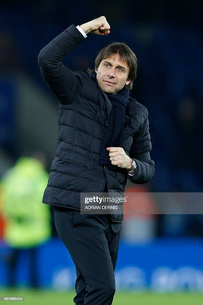 Chelsea's Italian head coach Antonio Conte celebrates on the pitch after the English Premier League football match between Leicester City and Chelsea at King Power Stadium in Leicester, central England on January 14, 2017. Cheslea won the game 3-0. / AFP / Adrian DENNIS / RESTRICTED TO EDITORIAL USE. No use with unauthorized audio, video, data, fixture lists, club/league logos or 'live' services. Online in-match use limited to 75 images, no video emulation. No use in betting, games or single club/league/player publications. /
