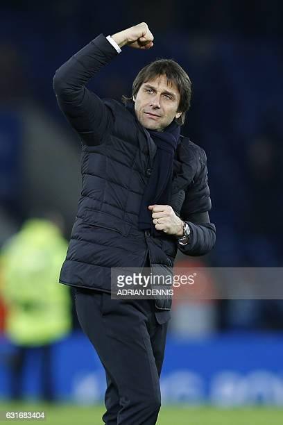 Chelsea's Italian head coach Antonio Conte celebrates on the pitch after the English Premier League football match between Leicester City and Chelsea...