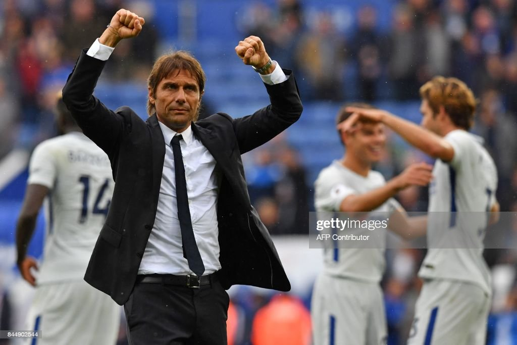 Chelsea's Italian head coach Antonio Conte celebrates on the pitch after the English Premier League football match between Leicester City and Chelsea at King Power Stadium in Leicester, central England on September 9, 2017. Chelsea won the game 2-1. / AFP PHOTO / Ben STANSALL / RESTRICTED TO EDITORIAL USE. No use with unauthorized audio, video, data, fixture lists, club/league logos or 'live' services. Online in-match use limited to 75 images, no video emulation. No use in betting, games or single club/league/player publications. /
