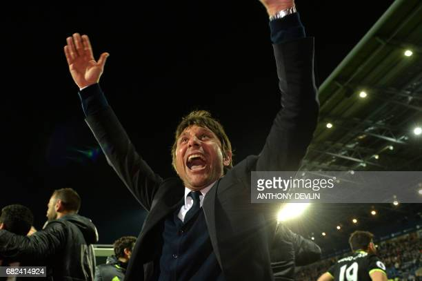 Chelsea's Italian head coach Antonio Conte celebrates victory after the English Premier League match between West Bromwich Albion and Chelsea at The...