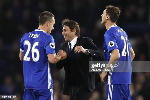 Chelsea's Italian head coach Antonio Conte celebrates with Chelsea's English defender John Terry and Chelsea's Serbian midfielder Nemanja Matic after...