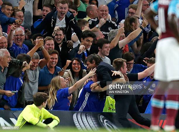 Chelsea's Italian head coach Antonio Conte celebrates with supporters after Chelsea's Brazilianborn Spanish striker Diego Costa scores their late...