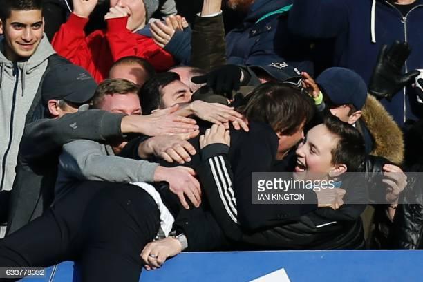 Chelsea's Italian head coach Antonio Conte celebrates with the crowd after Chelsea's Belgian midfielder Eden Hazard scored their second goal during...