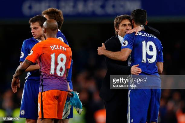 Chelsea's Italian head coach Antonio Conte congratulates Chelsea's Brazilianborn Spanish striker Diego Costa as Manchester City's English midfielder...