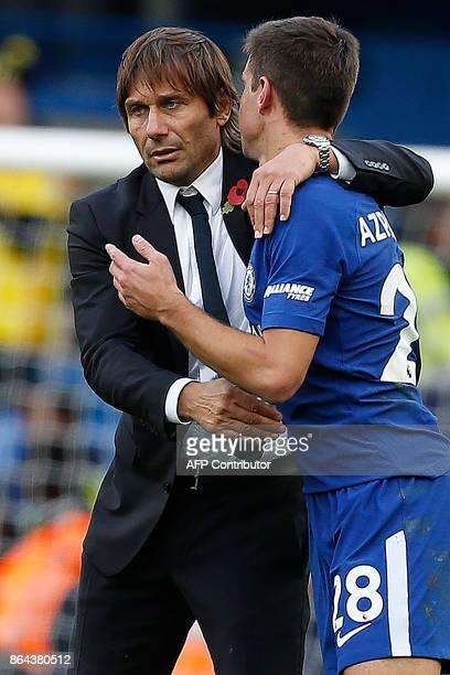 Chelsea's Italian head coach Antonio Conte congratulates Chelsea's Spanish defender Cesar Azpilicueta following the English Premier League football...