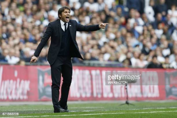 Chelsea's Italian head coach Antonio Conte gestures during the FA Cup semifinal football match between Tottenham Hotspur and Chelsea at Wembley...