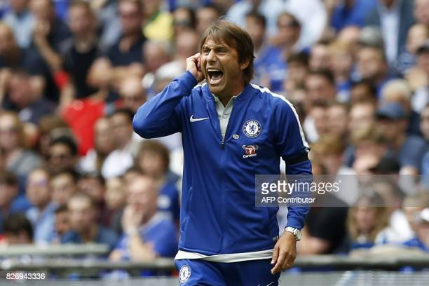 Chelsea's Italian head coach Antonio Conte gestures on the sideline during the FA Community Shield football match between Arsenal and Chelsea at...