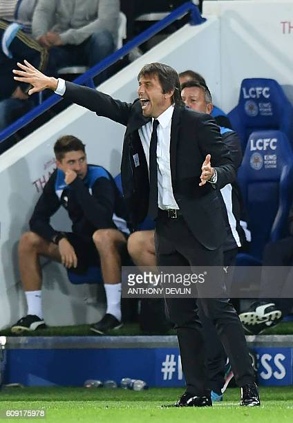 Chelsea's Italian head coach Antonio Conte gestures on the touchline during the English League Cup third round football match between Leicester City...
