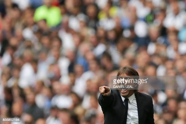 TOPSHOT Chelsea's Italian head coach Antonio Conte gestures on the touchline during the English Premier League football match between Tottenham...