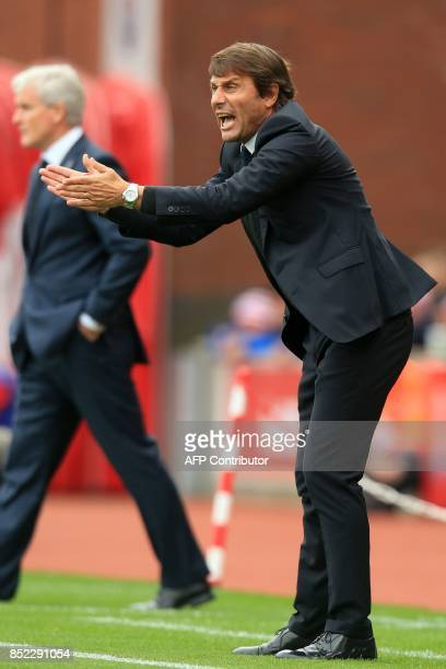 Chelsea's Italian head coach Antonio Conte gestures on the touchline during the English Premier League football match between Stoke City and Chelsea...
