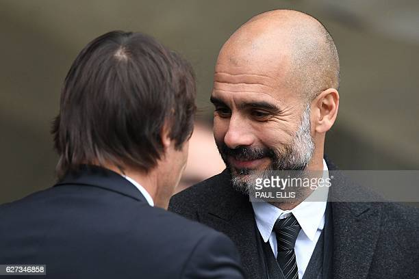 Chelsea's Italian head coach Antonio Conte greets Manchester City's Spanish manager Pep Guardiola ahead of the English Premier League football match...