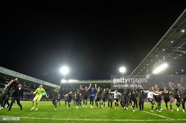 Chelsea's Italian head coach Antonio Conte leads celebrations of victory after the English Premier League match between West Bromwich Albion and...