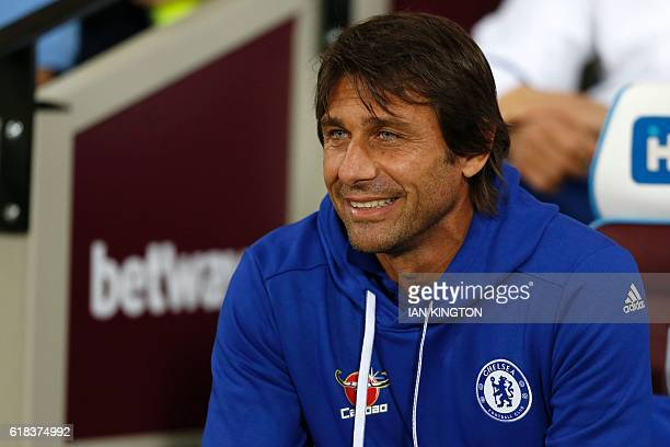 Chelsea's Italian head coach Antonio Conte looks on ahead of the EFL Cup fourth round match between West Ham United and Chelsea at The London Stadium...