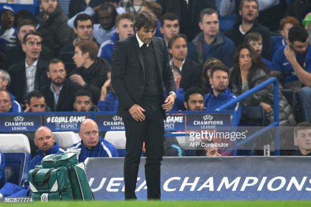 Chelsea's Italian head coach Antonio Conte reacts after Roma scored during a UEFA Champions league group stage football match between Chelsea and...