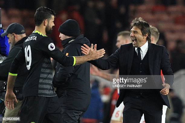Chelsea's Italian head coach Antonio Conte reacts as he congratulates Chelsea's Brazilianborn Spanish striker Diego Costa following the English...