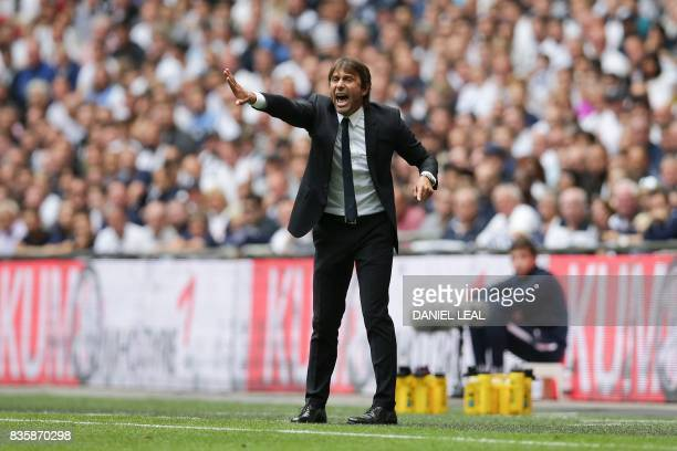 Chelsea's Italian head coach Antonio Conte reacts on the touchline during the English Premier League football match between Tottenham Hotspur and...