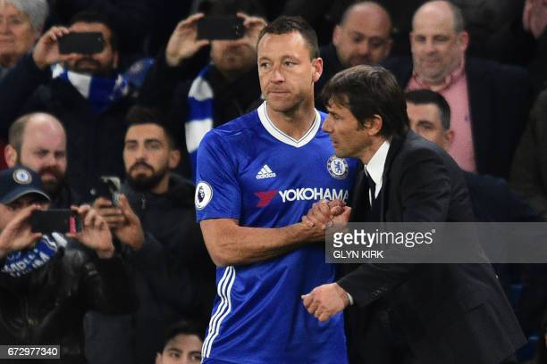 Chelsea's Italian head coach Antonio Conte sends on Chelsea's English defender John Terry as a late substitute in the English Premier League football...