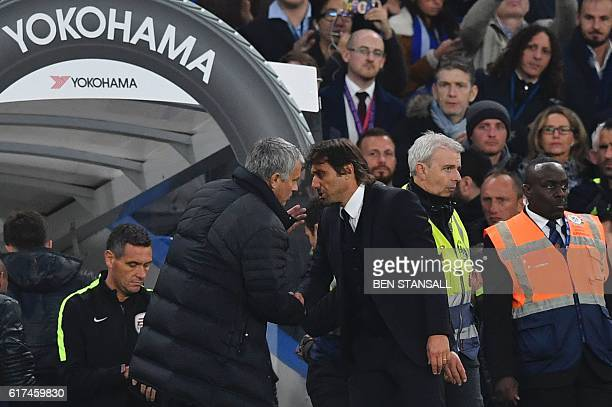 Chelsea's Italian head coach Antonio Conte shakes hands with Manchester United's Portuguese manager Jose Mourinho after the final whistle of the...