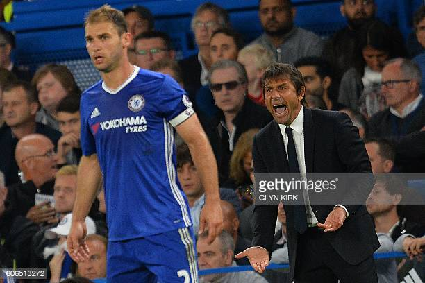 Chelsea's Italian head coach Antonio Conte shouts at Chelsea's Serbian defender Branislav Ivanovic during the English Premier League football match...